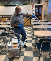 Jeffrey Ramos of the Vineland Public School District maintenance staff disinfects a Vineland High School South classroom on Feb. 9, 2020 as part of an ongoing effort to try to avoid any coronavirus exposure.