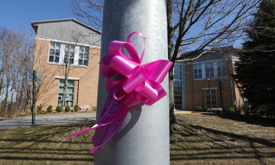 Pink ribbons were placed on a pole in front of Young Israel of New Rochelle March 9, 2020. The temple is under a precautionary quarantine because of the coronavirus.
