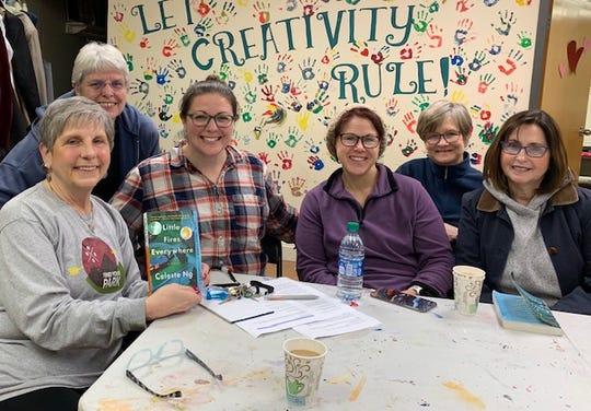 The New Deal Book Club, L to R Karen Gasparini (holding book), Pat Ault, Teresa Gasparini (New Deal Executive Director), Erica Woolley, June Archer, Virginia Poznack