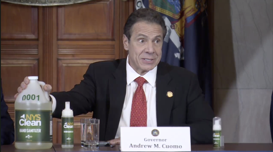 Gov. Andrew Cuomo displays NYS Clean, a new hand sanitizer the state will produce to deal with a shortage nationwide.