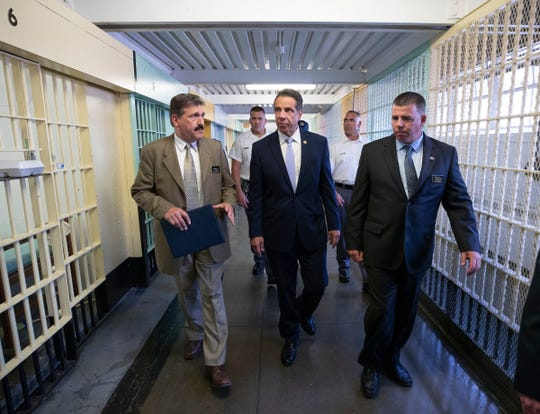 In this 2018 file photo, Gov. Andrew M.Cuomo tours the Great Meadow Correctional Facility in Comstock, Washington County. In March 2020, the prison's inmates began producing hand sanitizer there amid a coronavirus outbreak.