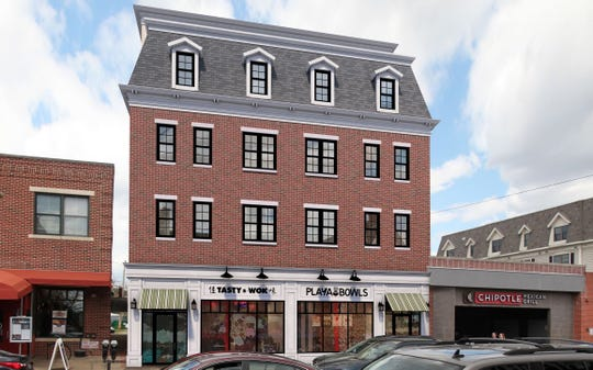 An artist's rendering of the student apartment building proposed by George Danneman at 132 E. Main St. The building will have two retail spaces on Main Street.