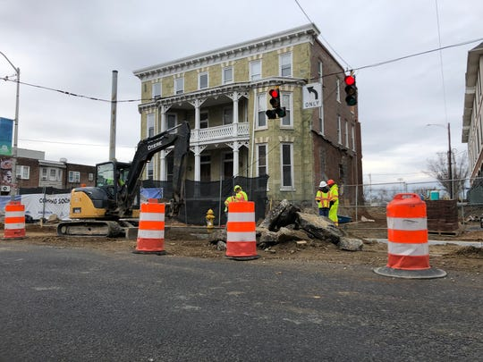Construction crews work in front of the Green Mansion on Newark's Main Street. The facade of the historic building will be incorporated in a hotel built by Newark-area developer Jeff Lang.