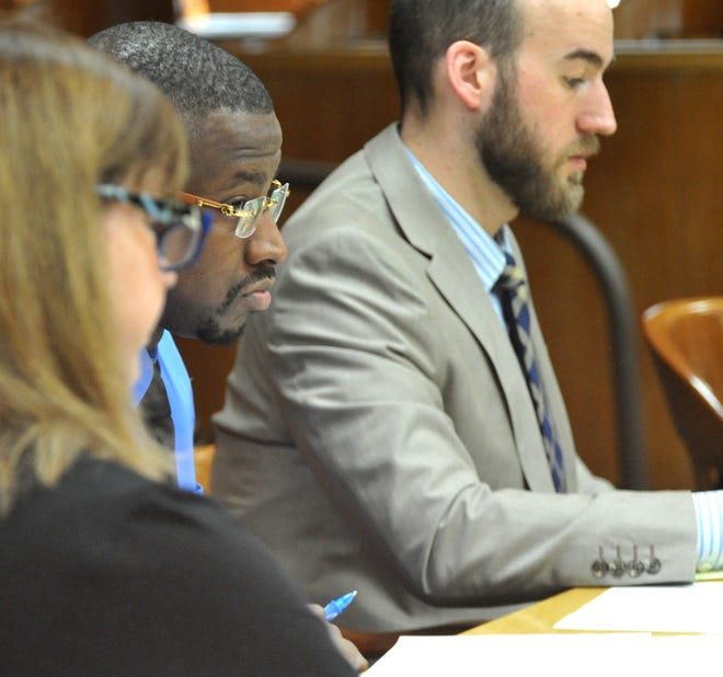 Jermar Fuller, center, listens as defense attorneys and prosecutors talked with potential jurors March 9 during the jury selection portion of his capital murder trial in 30th District Court. Fuller is accused of murdering William Rankin and David Phillips in October 2016 at a house on the city's north side.