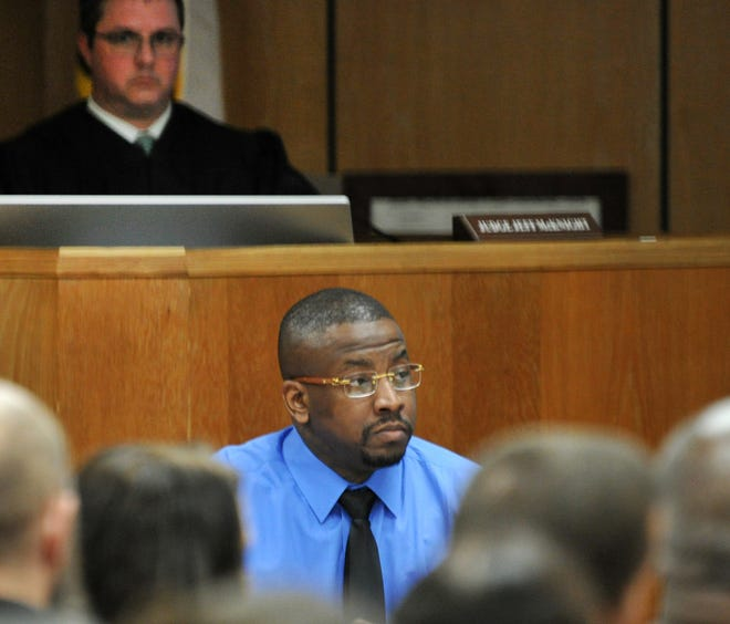Jermar Fuller, center, listens as his defense attorney and prosecutors talk with potential jurors March 9 during the jury selection portion of his capital murder trial in 30th District Court. Fuller is accused of murdering William Rankin and David Phillips in October 2016 at a house on the city's north side.