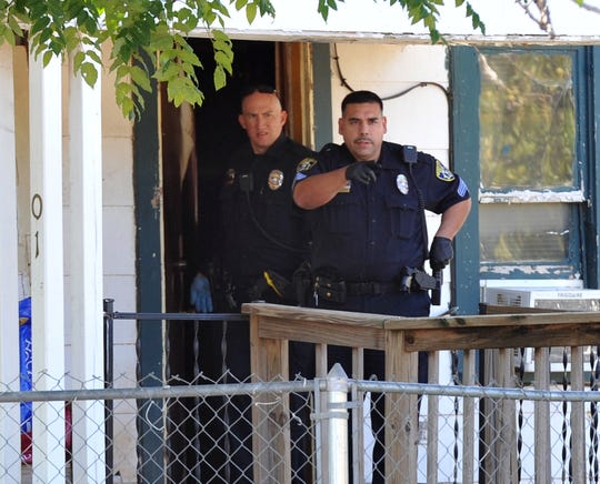 Wichita Falls police work to secure a crime the scene of a double homicide that occurred at a house in the 1300 block of North Third Street as shown in this Oct. 10, 2016, file photo. A woman discovered her son and his friend unresponsive that day in the home.
