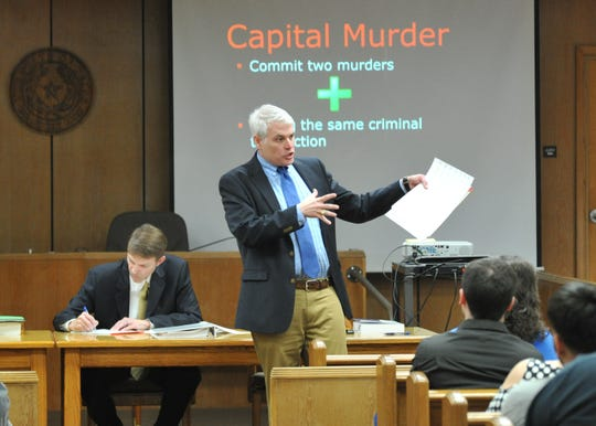 Wichita County District Attorney John Gillespie talks to a group of potential jurors Monday morning during the jury selection portion of Jermar Jamie Fuller's capital murder trial in the 30th district courtroom.  Assistant DA Kyle Lessor is seated on the left. Fuller is accused of a double murder on the north side of Wichita Falls in October 2016.