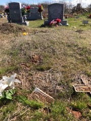 """A temporary marker for the grave of Lawrence """"Doby"""" Williams is visible in the foreground. Two friends of his, Ron Burdick and Steve Garner, found it Monday."""