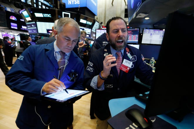 Trader Timothy Nick, left, and specialist Michael Pistillo work on the floor of the New York Stock Exchange on March 9. U.S. stocks collapsed after a free fall in oil prices and mounting coronavirus cases ratcheted up fear among investors and threatened to snuff out the longest bull market on the very day it was supposed to turn 11.