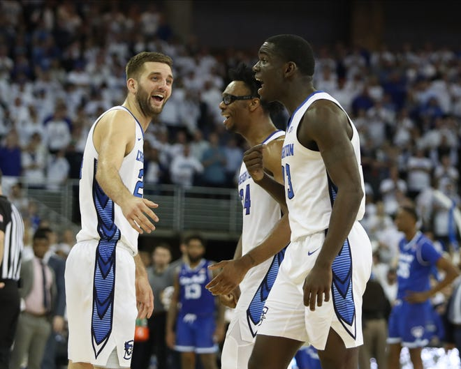 Creighton Bluejays guard Mitch Ballock (24), guard Denzel Mahoney (34) and forward Damien Jefferson (23) celebrate after defeating the Seton Hall Pirates at CHI Health Center Omaha. Creighton beat Seton Hall 77-60.
