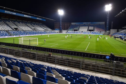 A view of the empty Mapei stadium as the Serie A soccer match between Sassuolo and Brescia is being played behind closed doors, in Reggio Emilia, Monday, March 9, 2020. Italian Premier Giuseppe Conte says he is restricting travel  nationwide to try to stop the spread of the new coronavirus. Conte said Monday night a new government decree will require all people in Italy to demonstrate they need to work, have health conditions or other limited legitimate reasons to travel outside their home areas.