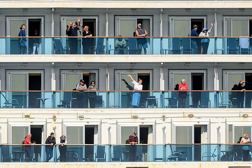 Passenger aboard the Grand Princess celebrate as they arrive in Oakland, Calif., on Monday, March 9, 2020. The cruise ship, which had maintained a holding pattern off the coast for days, is carrying multiple people who tested positive for COVID-19, a disease caused by the new coronavirus.