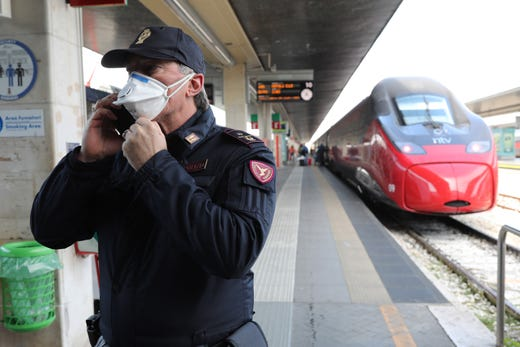 Policemen check citizens and tourists at the Venice Santa Lucia railway station, to make sure that they are not violating the quarantine, before they get on the trains to leave the city on March 9, 2020 in Venice, Italy. Prime Minister Giuseppe Conte announced a