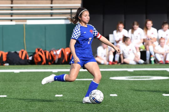 Cooper's Megan Melchor (7) passes the ball during Monday's District 4-5A contest against Aledo at Shotwell Stadium on March 9, 2020. It's the final game the Lady Cougars played before their season was put on hold due to the coronavirus outbreak.