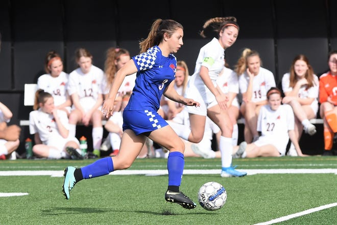 Cooper's Victoria Damian (3) carries the ball past midfield during Monday's District 4-5A contest against Aledo at Shotwell Stadium on March 9, 2020.