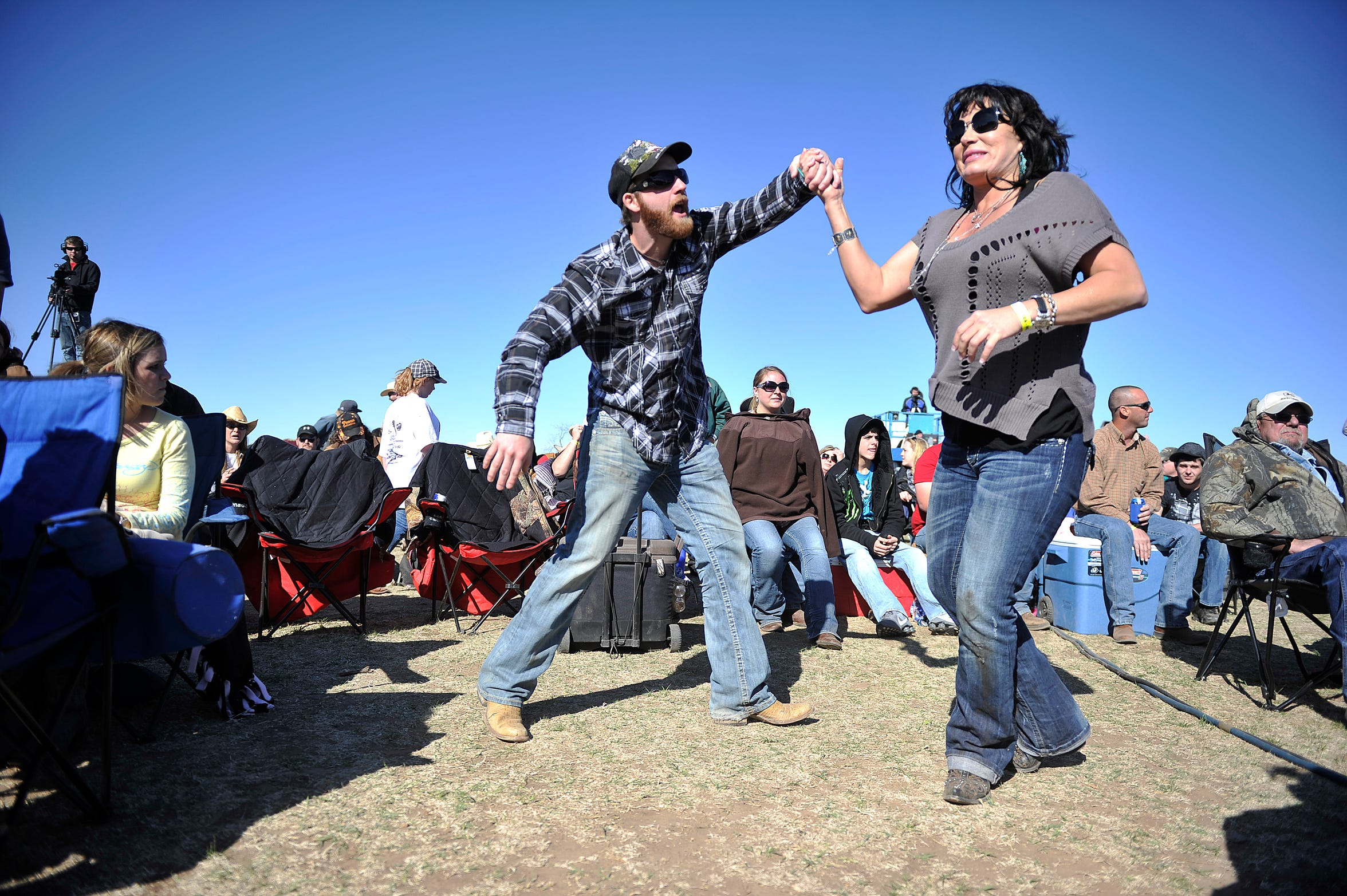 Jared Scott, left, and Shayla Griffon of Potosi dance while Bleu Edmondson plays during the Outlaws & Legends festival at Joe Allen's Lytle Bend Ranch on Saturday, March 5, 2011.