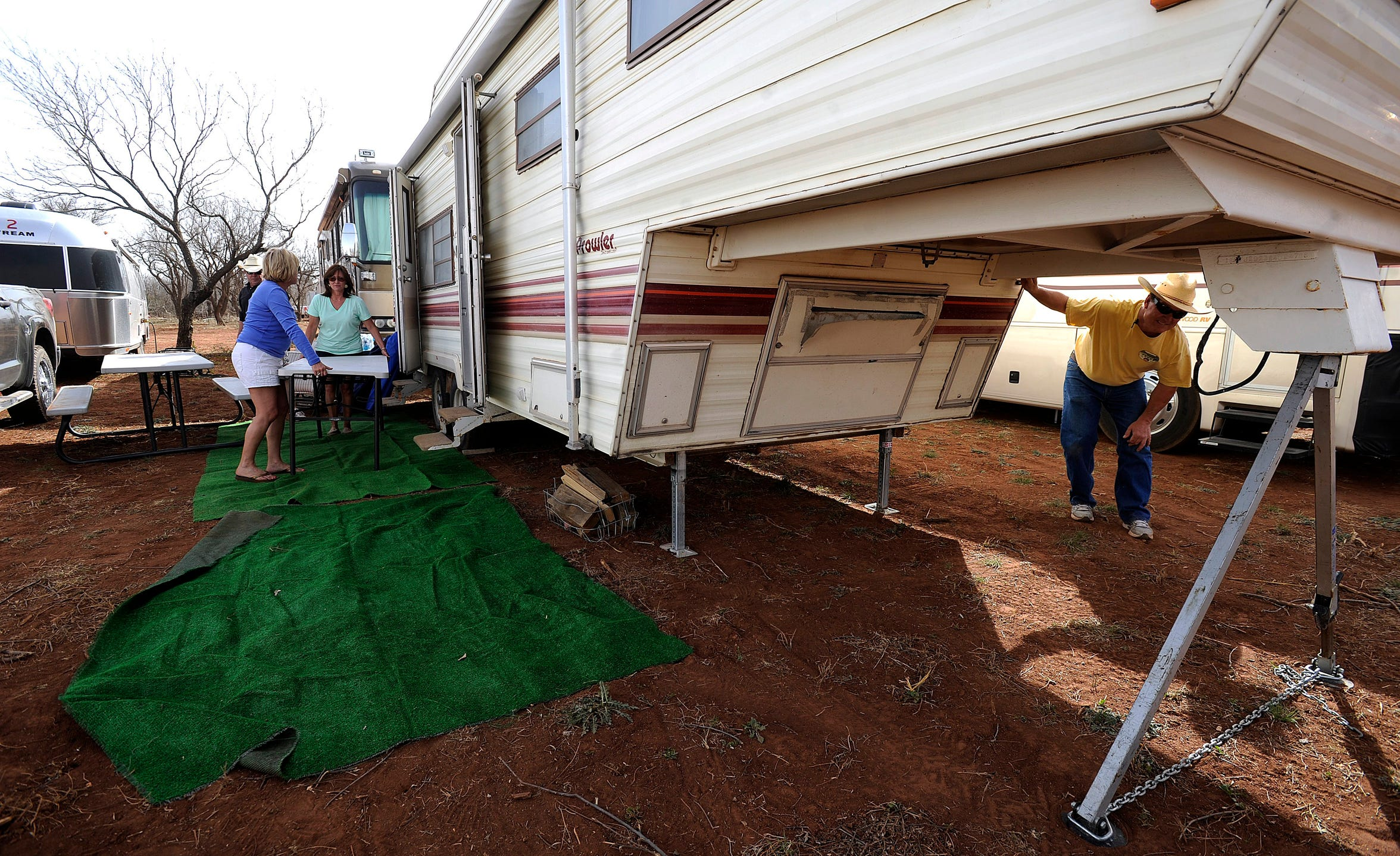 Todd Ethridge (right), of Coleman, sets up his camper in the RV area of the Back Porch of Texas. RV spots have topped 400, and all are gone for this year's 10th anniversary show.