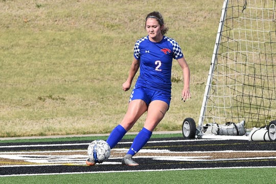 Cooper's Taryn Hagood (2) takes a goal kick during the District 4-5A contest against Aledo on March 9 at Shotwell Stadium.