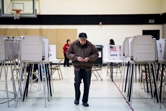Bill Morris votes at Battle Creek First Assembly of God on Tuesday, March 10, 2020 in Battle Creek, Mich. Battle Creek voters are selecting presidential candidates and voting on two proposals, one that would change how the mayor is elected and one that would change the city charter to use ungendered language.