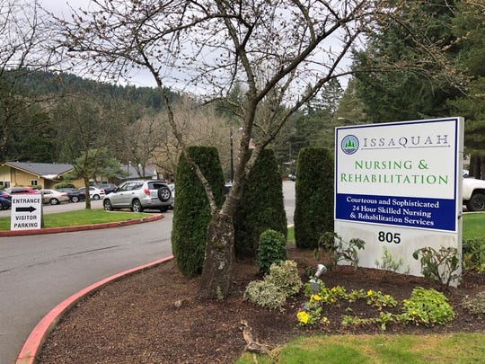 The visitor entrance is seen to the Issaquah Nursing and Rehabilitation Center in Issaquah, east of Seattle, the site of the latest death from the new coronavirus in Washington state on Tuesday, March 10, 2020. The Issaquah Nursing and Rehabilitation Center on Tuesday, announced that five residents and two staff have tested positive for the new coronavirus. They said a resident also died over the weekend.