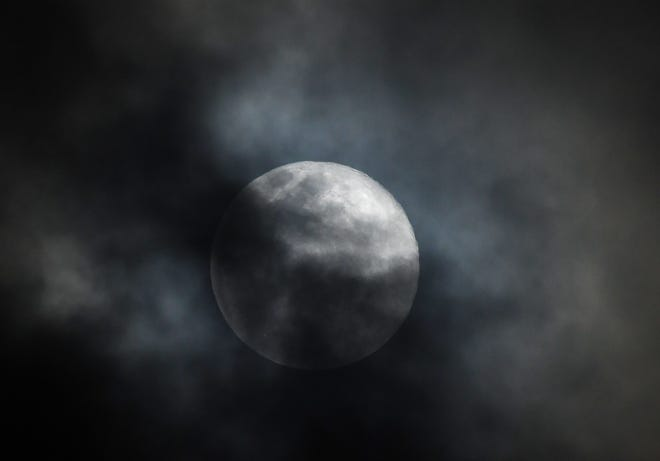 """A full moon """"supermoon"""" on March 9, as seen from Viera, Fl."""
