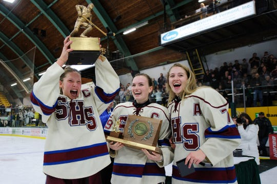 Spaulding celebrates the championship during the girls DII hockey championship game between the CVU/MMU Cougar Hawks and the Spaulding Crimson Tide at Gutterson Field House on Monday night March 9, 2020 in Burlington, Vermont.