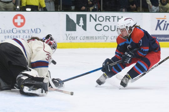 CVU/MMU's Nicole Wright, right, takes a shot during the Division II high school girls hockey state championship game earlier this month.