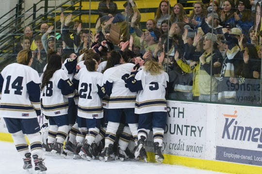 Essex celebrates the championship during the girls DI hockey championship game between the Essex Hornets and the Burlington/Colchester SeaLakers at Gutterson Field House on Monday night March 9, 2020 in Burlington, Vermont