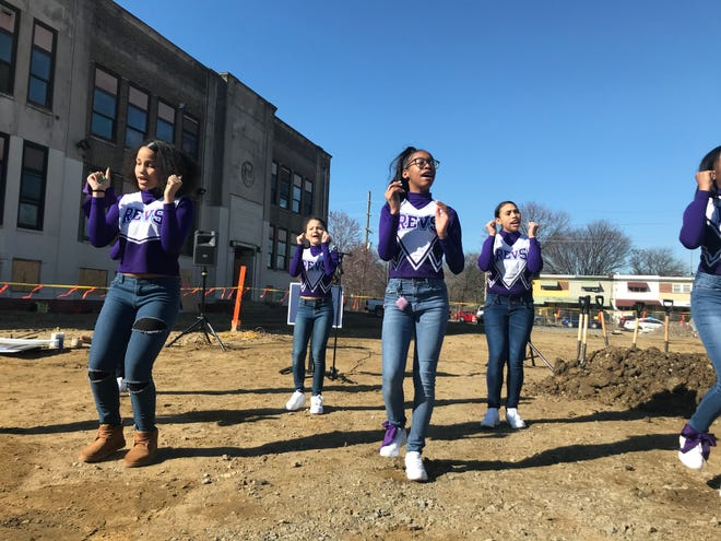 Members of the KIPP Cooper Norcross Middle School cheer team perform outside the new KIPP high school, set to open in the fall at the former Charles Sumner Elementary School.