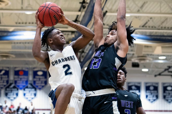 Timber Creek's Eric Benjamin (2) attempts a shot against Cherry Hill West's Jaydon Davis (13) at Timber Creek High School in Sicklerville, N.J. Monday, March 9, 2020. Timber Creek won  66-59, earning a South Jersey Group 3 championship.