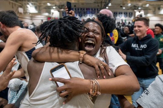 Timber Creek fans empty onto the court to celebrate a South Jersey Group 3 championship win over Cherry Hill West at Timber Creek High School in Sicklerville, N.J. Monday, March 9, 2020. The final score was 66-59.