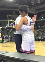 Conner senior Jalen Scott talks to head coach Matthew Otte after walking off the floor for the last time. March 9, 2020