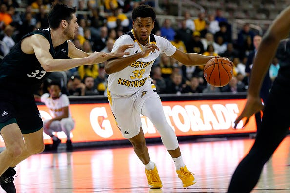 Dantez Walton #32 of the Northern Kentucky Norse drives to the basket while being guarded by Cody Schwartz #33 of the Green Bay Phoenix during the first half at Indiana Farmers Coliseum on March 09, 2020 in Indianapolis, Indiana.