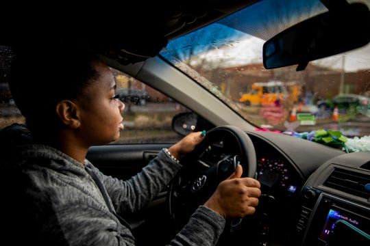 """Page Berry drops off her three daughters at school in Northside on Tuesday, February 4, 2020 after working third shift at the airport. Before the girls leave the car, Berry asks, """"What are we going to do today?"""" They reply in unison, """"Be great! And do great things!"""""""