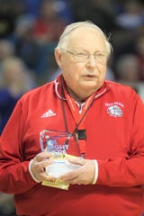 Gary Huhn, a teacher at Holmes High School for more than 50 years and a longtime contributor to athletics, was given a special award by St. Elizabeth at the 2020 Ninth Region Tournament.