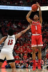Dec 18, 2019; Louisville, KY, USA; Miami RedHawks guard Nike Sibande (1) shoots against Louisville Cardinals guard David Johnson (13) during the first half at KFC Yum! Center.