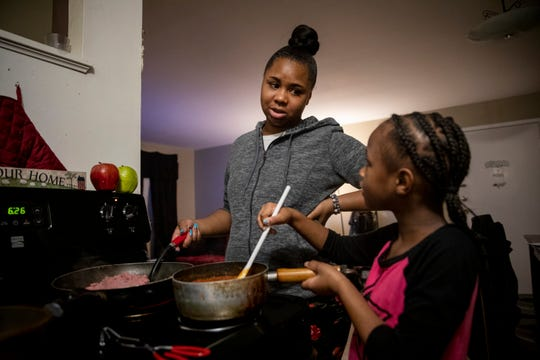 Page Berry makes dinner with the help of her daughter Ajaunae, 8, in their Westwood apartment on Tuesday, February 4, 2020.