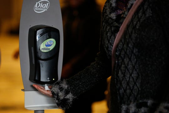Guests stop by a hand sanitizer station as they leave a city summit to give an update on the COVID-19 situation at the Duke Energy Convention Center in downtown Cincinnati on Tuesday, March 10, 2020.