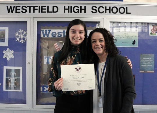 Westfield High School freshman Alexandra Cicala, pictured here with principal Mary Asfendis, is a recipient of the President's Volunteer Service Award which recognizes people of all ages who have volunteered significant amounts of time to their communities.  Cicala also received the Prudential Spirit of Community Award for exemplary volunteer service.