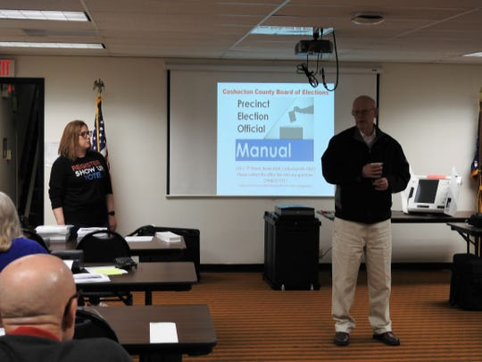 Kirsten Ross, assistant director of Coshocton County Board of Elections, and Mike Remington, member of the BOE, talk about policies and protocol during poll worker training for the primary.