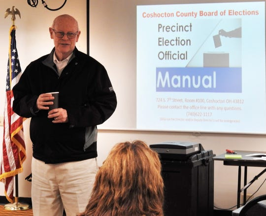 Mike Remington of the Coshocton County Board of Elections talks with poll workers at the Coshocton County Services Building,  going over protocol and policies for the primary on Tuesday.