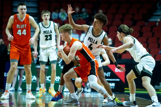 Sergeant Bluff-Luton's Deric Fitzgerald tries to keep possession of the ball while Pella players doubleteam during the Pella vs. Sergeant Bluff-Luton boys' basketball state tournament Class 3A quarterfinal on Tuesday, March 10, 2020, at Wells Fargo Arena in Des Moines.