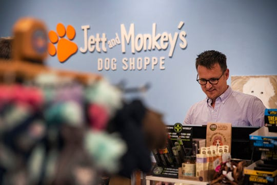"Josh Garrett assists a customer at Monkey's Dog Shoppe on March 9, 2020 in Des Moines. Having owned the shop for ten years, Garrett says small business owners shouldn't be worried about increasing e-commerce in the metro — instead, ""big-box"" retailers should be. ""Just look at Valley West Mall in the past couple years,"" Garrett said."