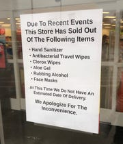 A sign is posted at a Des Moines area store noting that they have sold out of specific products related to the coronavirus outbreak in Iowa and around the nation.