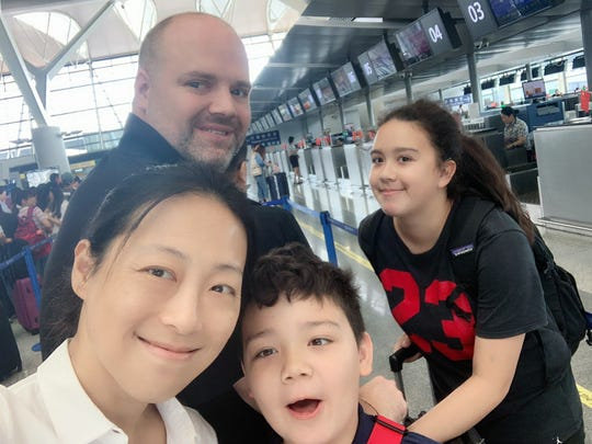 Andrew Parrish, his wife Meng Lu (front), son, Aaron, and daughter, Shirley, at Shanghai Pudong International Airport heading to the United States for Christmas in 2019.