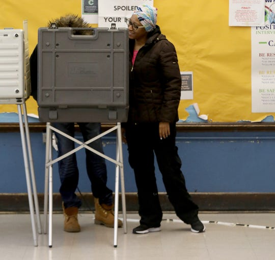 Kerwin Brown-El, 60, of Detroit gets help from his fiance Veronica Harrison, 34 of Detroit, while voting for the first time at precinct 212 and 213 inside Thurgood Marshall Elementary School Detroit, Michigan on Tuesday, March 10, 2020.