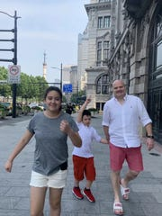 Andrew Parrish and his son and daughter walk along The Bund in Shanghai in August 2019. The Bund is the old historic downtown district.