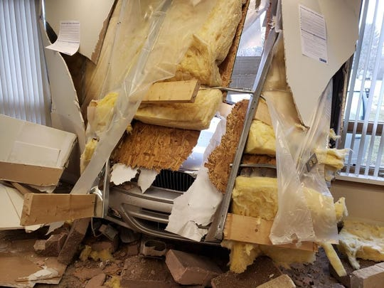 A car crashed through the wall of a polling place Tuesday, in Berrien County's Coloma Township in southwest Michigan.