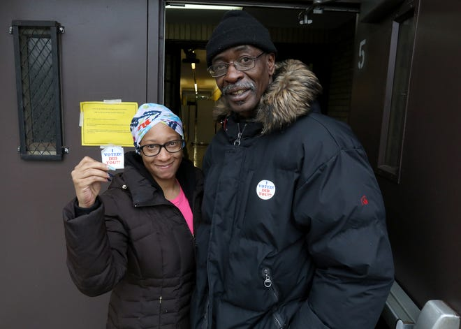 Veronica Harrison, 34, of Detroit and fiance Kerwin Brown-El, 60, of Detroit after they voted at precinct 212 and 213 inside Thurgood Marshall Elementary School Detroit on Tuesday, March 10, 2020.