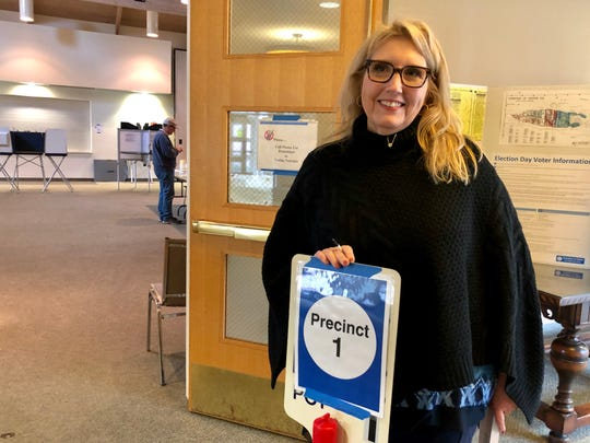 Claudia Simons, an election worker at Grosse Ile Presbyterian Church, on Tuesday, March 10, 2020.